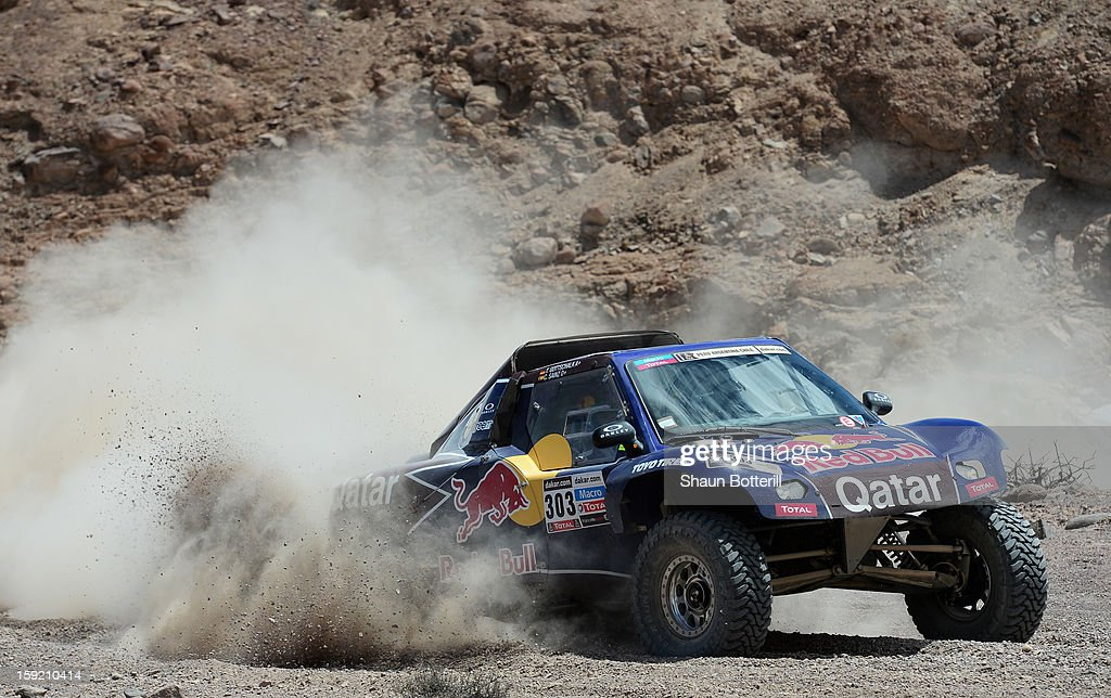 <a gi-track='captionPersonalityLinkClicked' href=/galleries/search?phrase=Carlos+Sainz+-+Born+1962&family=editorial&specificpeople=14996439 ng-click='$event.stopPropagation()'>Carlos Sainz</a> and co-pilot Timo Gottschalk of team Buggy compete in stage 5 from Arequipa to Arica during the 2013 Dakar Rally on January 9, 2013 in Arequipa, Peru.