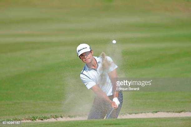 Carlos Sainz Jr of the United States hits out of the bunker at the 18th hole during the third round of the PGA TOUR Latinoamérica Honduras Open...