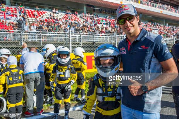 Carlos Sainz of Scuderia Toro Rosso and Spain with Luna De La Rosaand the kids from the Fernando Alonso of McLaren and Spain Go Kart School during...