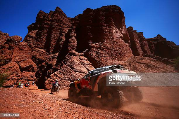 Carlos Sainz of Spain and Peugeot drives with codriver Lucas Cruz of Spain in the 3008 DKR Peugeot car in the Classe T14 2 Roues Motrices Diesel...
