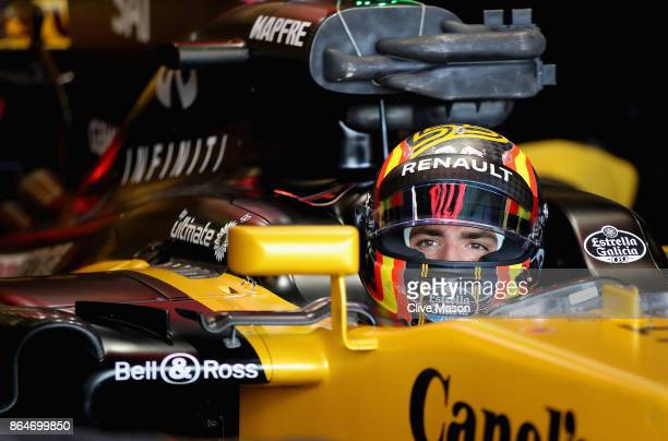 Carlos Sainz of Spain and Renault Sport F1 prepares to drive in the garage during final practice for the United States Formula One Grand Prix at...