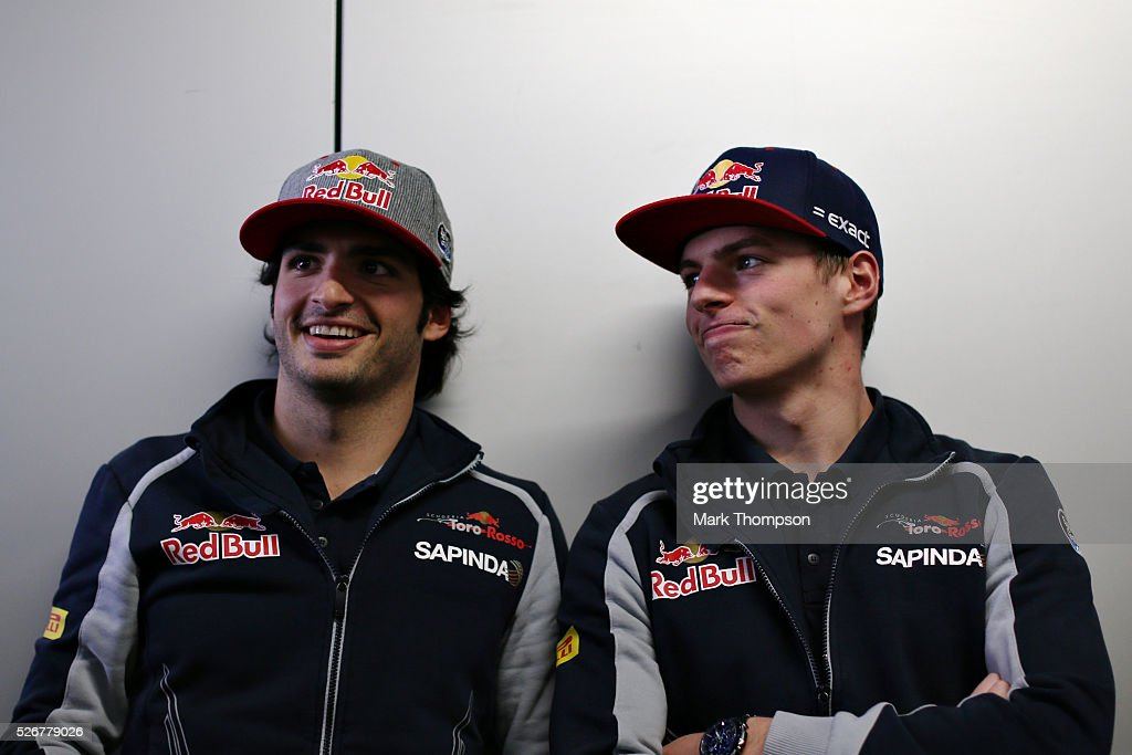 Carlos Sainz of Spain and Scuderia Toro Rosso and Max Verstappen of Netherlands and Scuderia Toro Rosso talk while waiting for the drivers parade ahead of the Formula One Grand Prix of Russia at Sochi Autodrom on May 1, 2016 in Sochi, Russia.