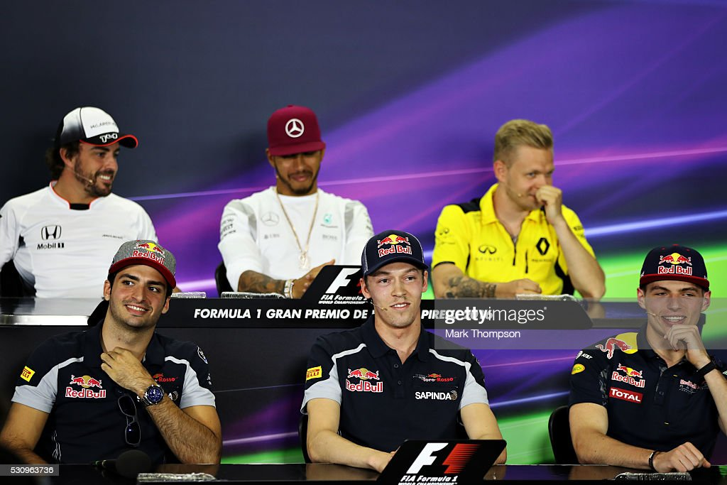 Carlos Sainz of Spain and Scuderia Toro Rosso, Daniil Kvyat of Russia and Scuderia Toro Rosso and Max Verstappen of Netherlands and Red Bull Racing smile in the Drivers Press Conference during previews to the Spanish Formula One Grand Prix at Circuit de Catalunya on May 12, 2016 in Montmelo, Spain.