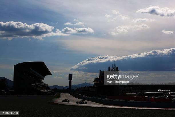 Carlos Sainz of Spain and Scuderia Toro Rosso drives ahead of Marcus Ericsson of Sweden and Sauber F1 during day two of F1 winter testing at Circuit...