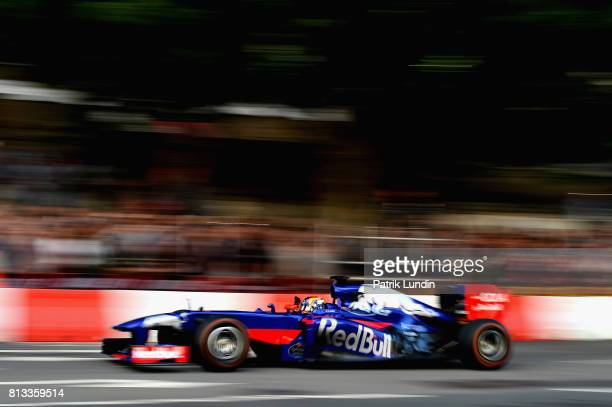 Carlos Sainz of Spain and Scuderia Toro Rosso drives the STR8 during F1 Live London at Trafalgar Square on July 12 2017 in London England F1 Live...