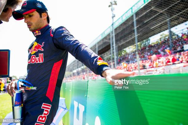 Carlos Sainz of Spain and Scuderia Toro Rosso prepares to drive on the grid before the Formula One Grand Prix of Italy at Autodromo di Monza on...
