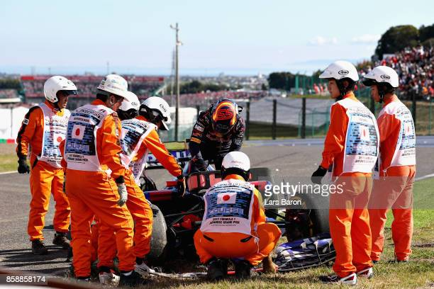 Carlos Sainz of Spain and Scuderia Toro Rosso retires from the race during the Formula One Grand Prix of Japan at Suzuka Circuit on October 8 2017 in...