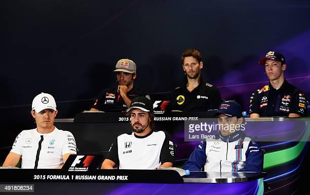 Carlos Sainz of Spain and Scuderia Toro Rosso Romain Grosjean of France and Lotus and Daniil Kvyat of Russia and Infiniti Red Bull Racing Nico...