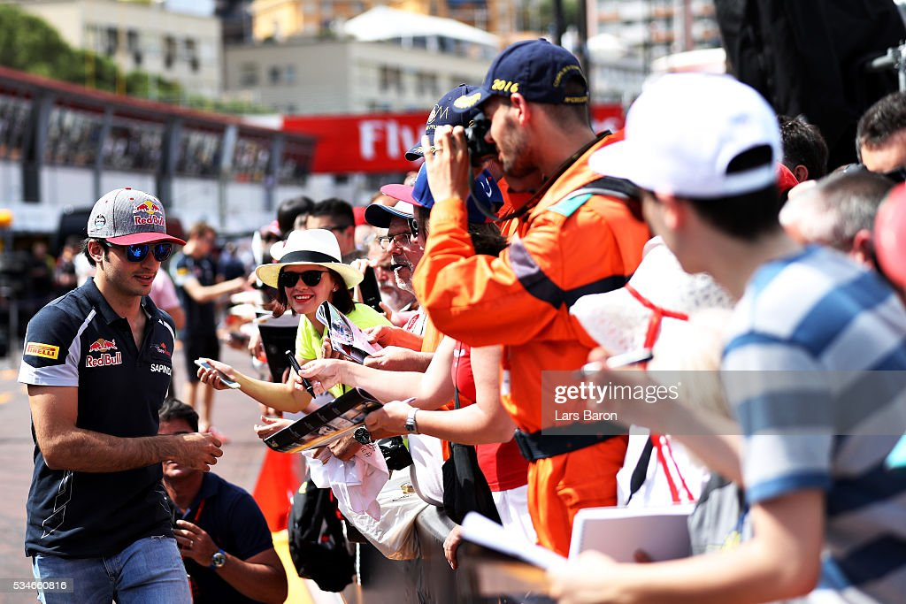 Carlos Sainz of Spain and Scuderia Toro Rosso signs autographs for fans during previews to the Monaco Formula One Grand Prix at Circuit de Monaco on May 27, 2016 in Monte-Carlo, Monaco.