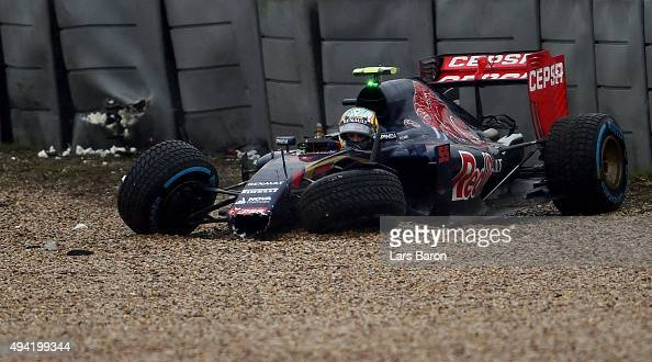 Carlos Sainz of Spain and Scuderia Toro Rosso sits in his car after crashing during qualifying before the United States Formula One Grand Prix at...