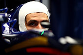 Carlos Sainz of Spain and Scuderia Toro Rosso sits in his car in the garage during practice for the Formula One Grand Prix of Japan at Suzuka Circuit...