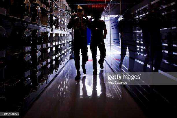 Carlos Sainz of Spain and Scuderia Toro Rosso walks in the garage during practice for the Spanish Formula One Grand Prix at Circuit de Catalunya on...