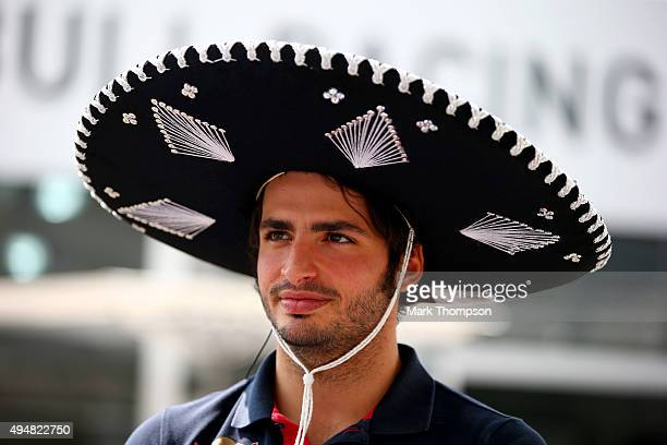 Carlos Sainz of Spain and Scuderia Toro Rosso wears a sombrero as he walks in the paddock during previews to the Formula One Grand Prix of Mexico at...