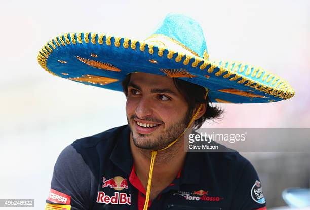 Carlos Sainz of Spain and Scuderia Toro Rosso wears a sombrero as he takes part in the drivers' parade before the Formula One Grand Prix of Mexico at...