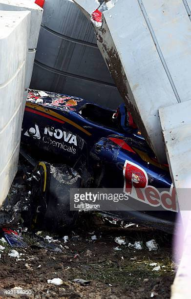 Carlos Sainz of Spain and Scuderia Toro Rosso's damaged car after he crashed during final practice for the Formula One Grand Prix of Russia at Sochi...