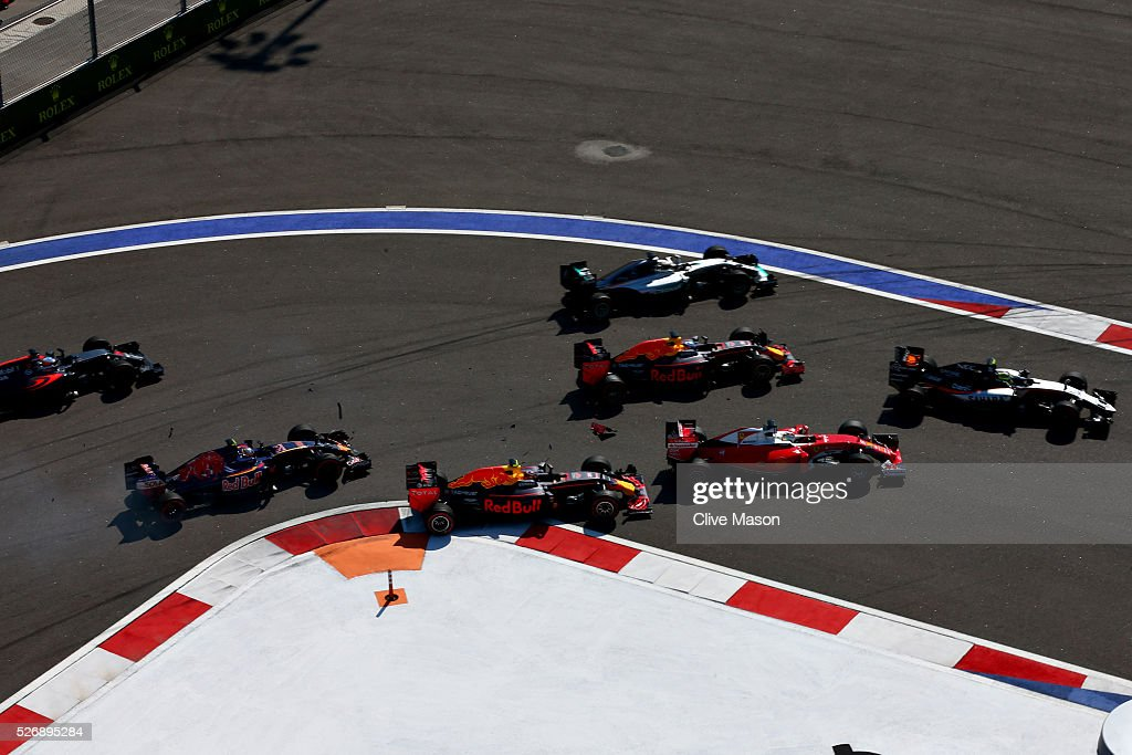 Carlos Sainz of Spain driving the (55) Scuderia Toro Rosso STR11 Ferrari 060/5 turbo, <a gi-track='captionPersonalityLinkClicked' href=/galleries/search?phrase=Daniil+Kvyat&family=editorial&specificpeople=10936016 ng-click='$event.stopPropagation()'>Daniil Kvyat</a> of Russia driving the (26) Red Bull Racing Red Bull-TAG Heuer RB12 TAG Heuer, <a gi-track='captionPersonalityLinkClicked' href=/galleries/search?phrase=Daniel+Ricciardo&family=editorial&specificpeople=6547569 ng-click='$event.stopPropagation()'>Daniel Ricciardo</a> of Australia driving the (3) Red Bull Racing Red Bull-TAG Heuer RB12 TAG Heuer, <a gi-track='captionPersonalityLinkClicked' href=/galleries/search?phrase=Sebastian+Vettel&family=editorial&specificpeople=2233605 ng-click='$event.stopPropagation()'>Sebastian Vettel</a> of Germany driving the (5) Scuderia Ferrari SF16-H Ferrari 059/5 turbo (Shell GP), <a gi-track='captionPersonalityLinkClicked' href=/galleries/search?phrase=Lewis+Hamilton&family=editorial&specificpeople=586983 ng-click='$event.stopPropagation()'>Lewis Hamilton</a> of Great Britain driving the (44) Mercedes AMG Petronas F1 Team Mercedes F1 WO7 Mercedes PU106C Hybrid turbo and Sergio Perez of Mexico driving the (11) Sahara Force India F1 Team VJM09 Mercedes PU106C Hybrid turbo at the start during the Formula One Grand Prix of Russia at Sochi Autodrom on May 1, 2016 in Sochi, Russia.