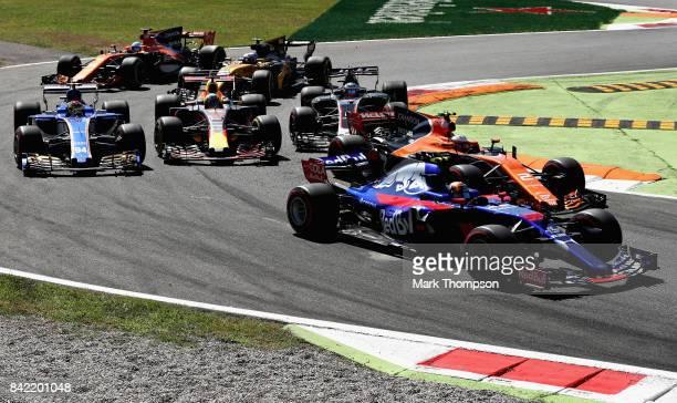 Carlos Sainz of Spain driving the Scuderia Toro Rosso STR12 battles with Stoffel Vandoorne of Belgium driving the McLaren Honda Formula 1 Team...
