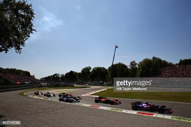 Carlos Sainz of Spain driving the Scuderia Toro Rosso STR12 leads Stoffel Vandoorne of Belgium driving the McLaren Honda Formula 1 Team McLaren MCL32...