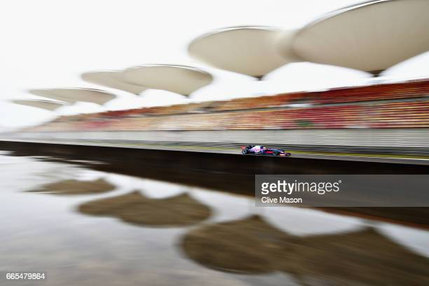 Carlos Sainz of Spain driving the Scuderia Toro Rosso STR12 on track during practice for the Formula One Grand Prix of China at Shanghai...