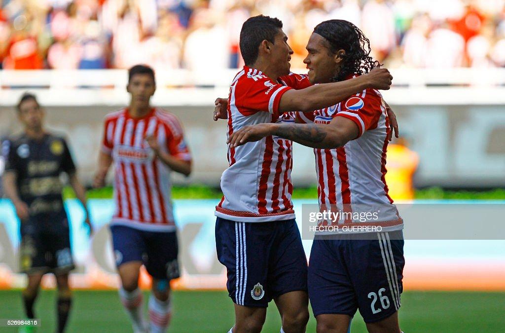Carlos Salcedo and Carlos Pena of Guadalajara celebrate after scoring against Dorados during their Mexican Clausura 2016 tournament football match at Chivas stadium on May 1, 2016 in Guadalajara, Mexico. / AFP / Hector_Guerrero