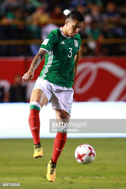 Carlos Salcedo of Mexico controls the ball during the match between Mexico and Trinidad Tobago as part of the FIFA 2018 World Cup Qualifiers at...