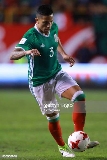 Carlos Salcedo of Mexico drives the ball during the match between Mexico and Trinidad Tobago as part of the FIFA 2018 World Cup Qualifiers at Alfonso...