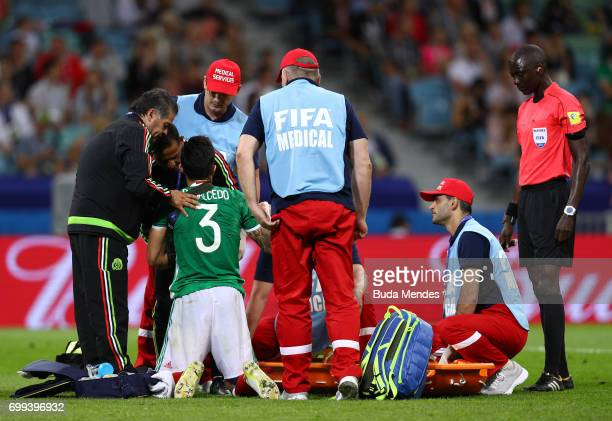 Carlos Salcedo of Mexico receives treatment from the medical team during the FIFA Confederations Cup Russia 2017 Group A match between Mexico and New...