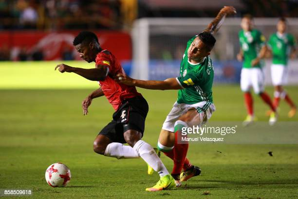 Carlos Salcedo of Mexico struggle for the ball against Kevon Villaroel of Trinidad Tobago during the match between Mexico and Trinidad Tobago as part...