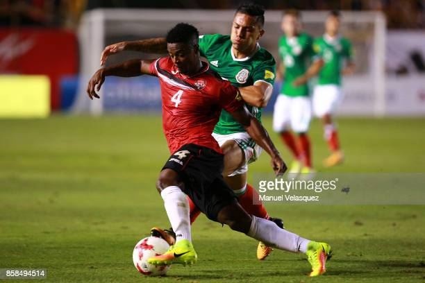 Carlos Salcedo of Mexico struggles for the ball with Kevon Villaroel of Trinidad Tobago during the match between Mexico and Trinidad Tobago as part...