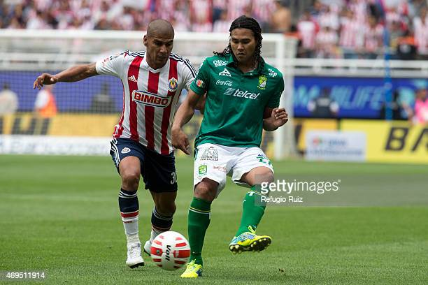 Carlos Salcido of Chivas fights for the ball with Alberto Peña of Leon during a match between Chivas and Leon as part of 13th round of Clausura 2015...