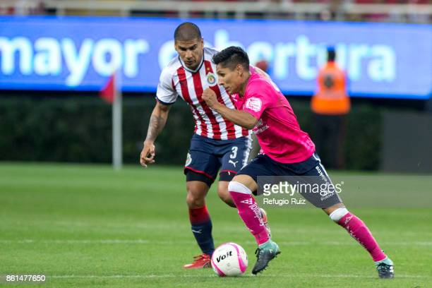 Carlos Salcido of Chivas fights for the ball with Raul Ruidiaz of Morelia during the 13th round match between Chivas and Morelia as part of the...