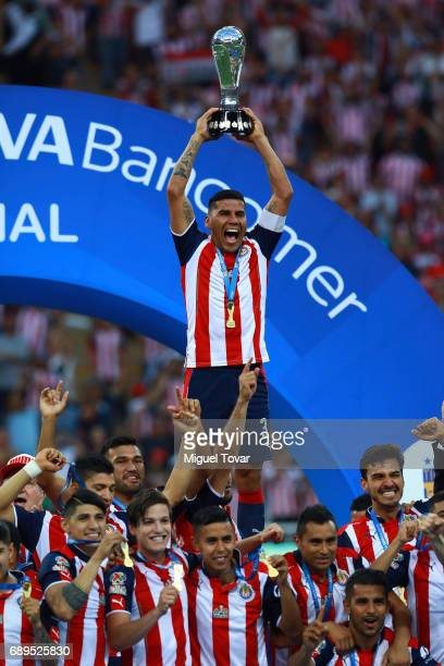 Carlos Salcido of Chivas lifts the trophy after winning during the Final second leg match between Chivas and Tigres UANL as part of the Torneo...