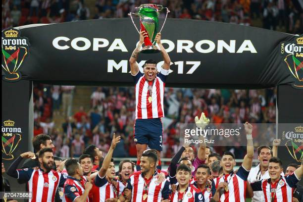 Carlos Salcido of Chivas lifts the trophy after winning the final match between Chivas and Morelia as part of the Copa MX Clausura 2017 at Chivas...