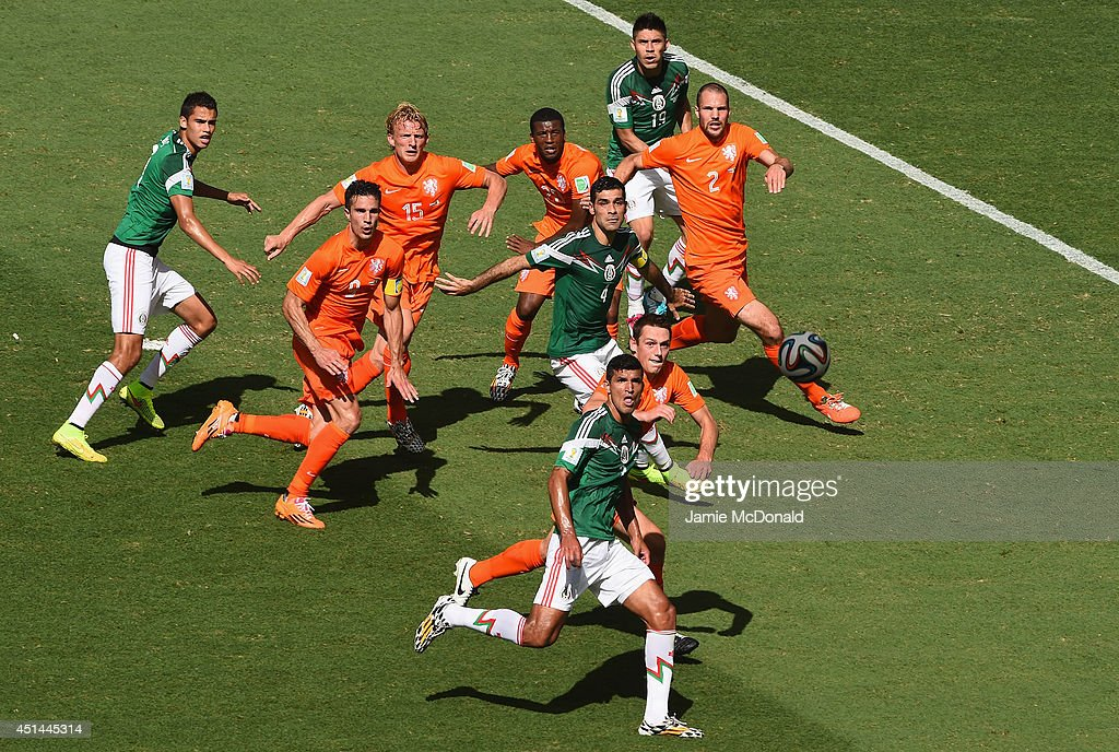 Carlos Salcido of Mexico and Daley Blind of Netherlands watch the ball during the 2014 FIFA World Cup Brazil Round of 16 match between Netherlands and Mexico at Castelao on June 29, 2014 in Fortaleza, Brazil.