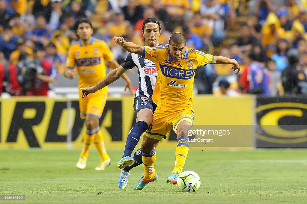 <a gi-track='captionPersonalityLinkClicked' href=/galleries/search?phrase=Carlos+Salcido&family=editorial&specificpeople=241267 ng-click='$event.stopPropagation()'>Carlos Salcido</a> of Tigres fights for the ball during the match between Tigres and Monterrey as part of the Clausura Tournament 2013 on May 11, 2013 in Monterrey, Mexico.