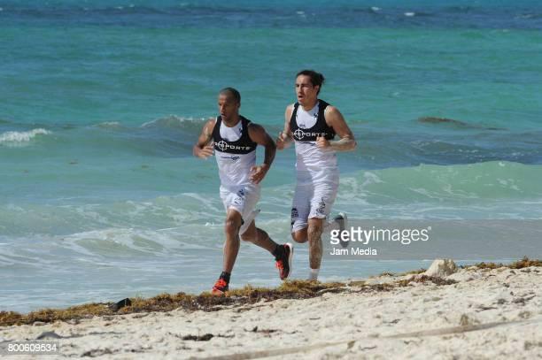 Carlos Sanchez and Efrain Juarez of Monterrey run in the beach during the Pre Season training for the Torneo Apertura 2017 Liga MX at Hotel Gran...