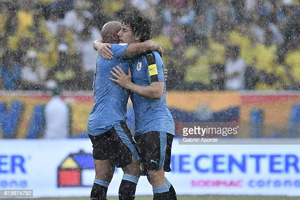Carlos Sanchez and Matias Corujo of Uruguay celebrate after a goal scored by teammate Cristian Rodriguez during a match between Colombia and Uruguay...