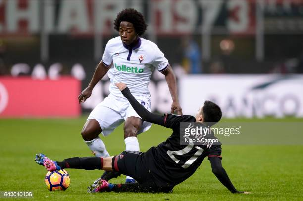Carlos Sanchez of ACF Fiorentina and Leonel Vangioni of AC Milan compete for the ball during the Serie A football match between AC Milan and ACF...