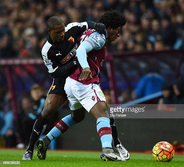Carlos Sanchez of Aston Villa and Odion Ighalo of Watford compete for the ball during the Barclays Premier League match between Aston Villa and...