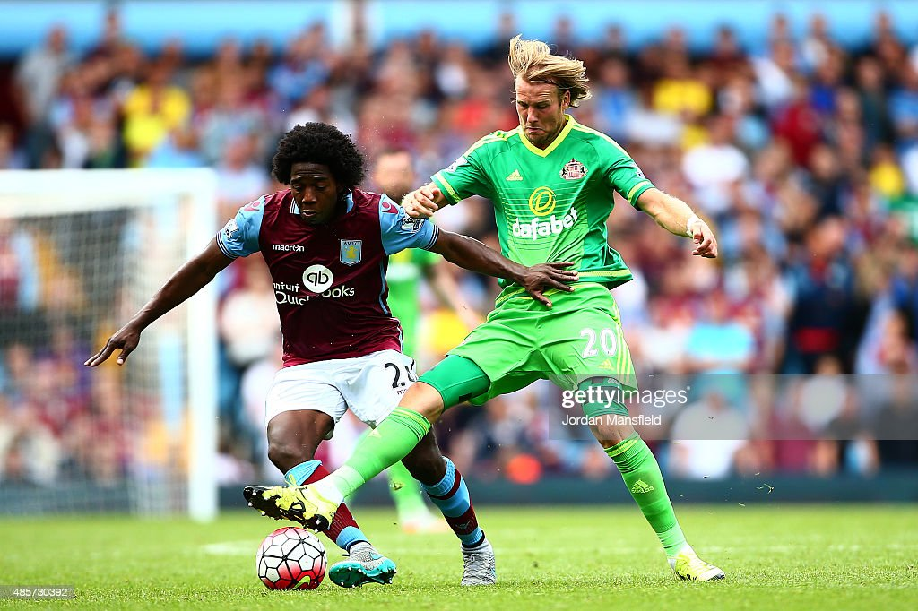Carlos Sanchez of Aston Villa and Ola Toivonen of Sunderland compete for the ball during the Barclays Premier League match between Aston Villa and Sunderland at Villa Park on August 29, 2015 in Birmingham, England.