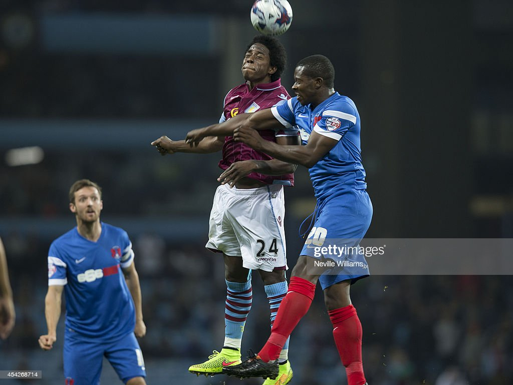 Carlos Sanchez of Aston Villa are challenged by Marvin Bartley of Leyton Orient during the Capital One Cup second round match between Aston Villa and Leyton Orient at Villa Park on August 27, 2014 in Birmingham, England.