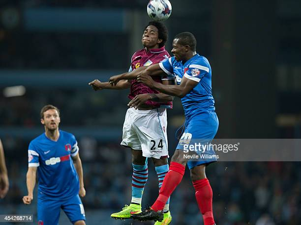 Carlos Sanchez of Aston Villa are challenged by Marvin Bartley of Leyton Orient during the Capital One Cup second round match between Aston Villa and...