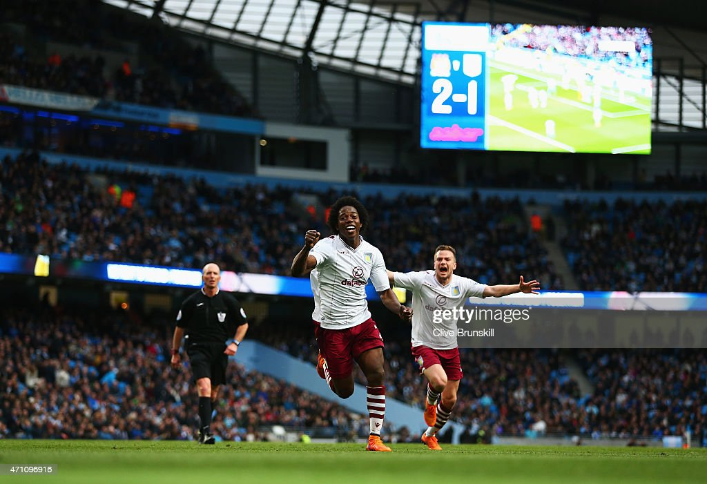 Carlos Sanchez of Aston Villa celebrates his goal with Tom Cleverley of Aston Villa during the Barclays Premier League match between Manchester City and Aston Villa at Etihad Stadium on April 25, 2015 in Manchester, England.