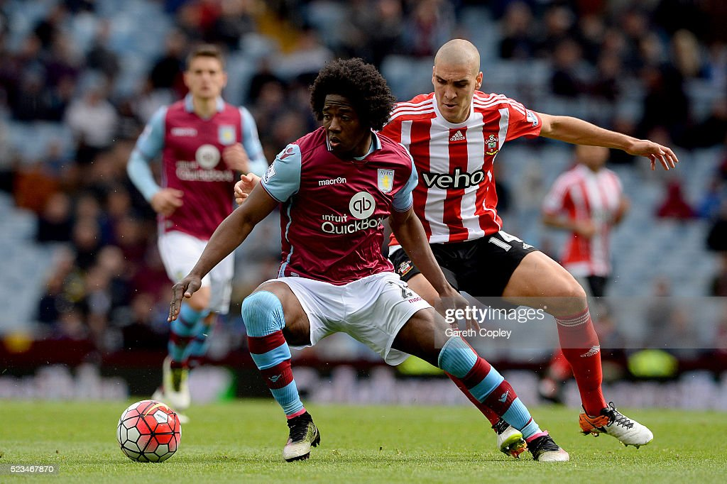Carlos Sanchez of Aston Villa holds of Oriol Romeu of Southampton during the Barclays Premier League match between Aston Villa and Southampton at...