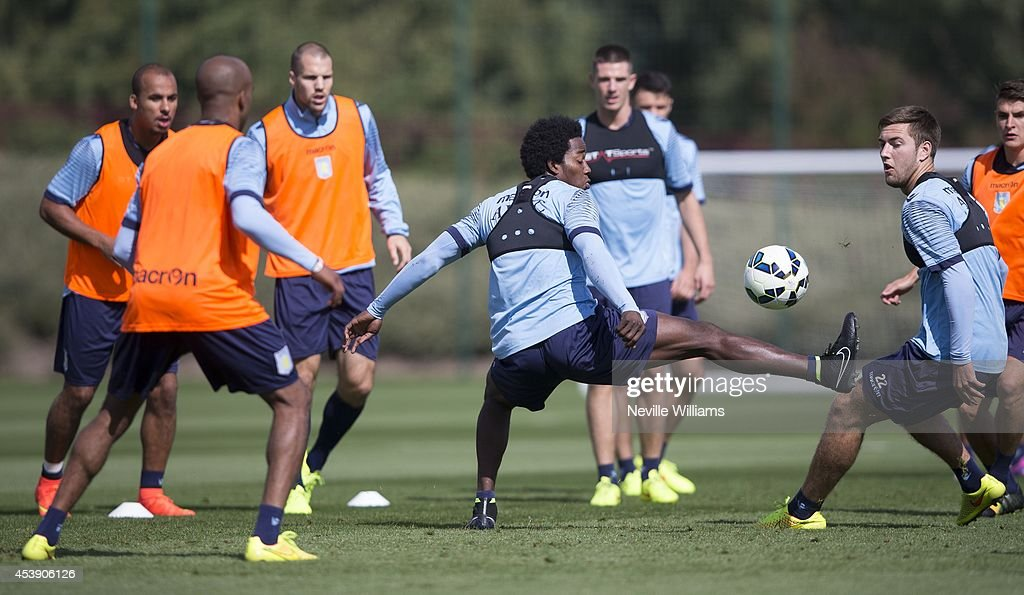 Carlos Sanchez of Aston Villa in action during a Aston Villa training session at the club's training ground at Bodymoor Heath on August 21, 2014 in Birmingham, England.