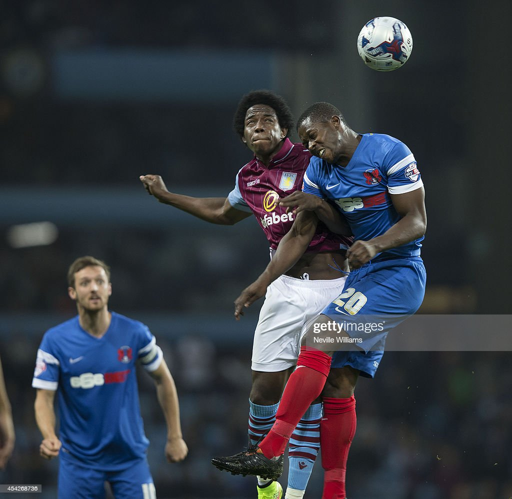 Carlos Sanchez of Aston Villa is challenged by Marvin Bartley of Leyton Orient during the Capital One Cup second round match between Aston Villa and Leyton Orient at Villa Park on August 27, 2014 in Birmingham, England.