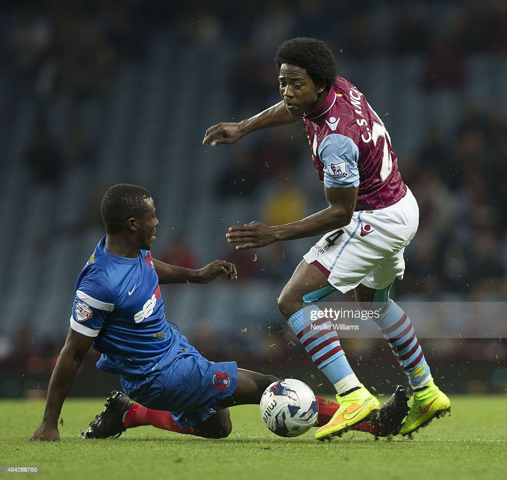 Carlos Sanchez (R) of Aston Villa is challenged by Marvin Bartley of Leyton Orient during the Capital One Cup second round match between Aston Villa and Leyton Orient at Villa Park on August 27, 2014 in Birmingham, England.