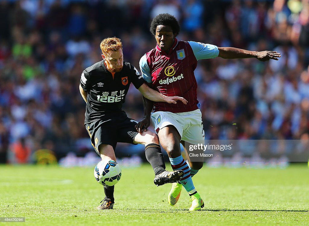 Carlos Sanchez of Aston Villa is challenged by Stephen Quinn of Hull City during the Barclays Premier League match between Aston Villa and Hull City...