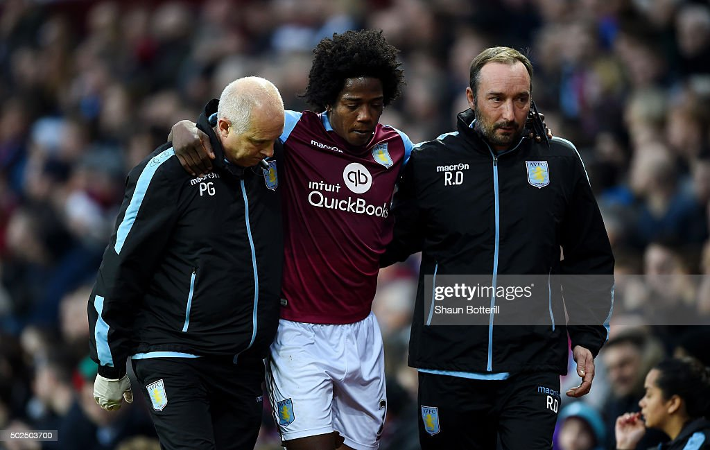 Carlos Sanchez of Aston Villa leaves the field injured during the Barclays Premier League match between Aston Villa and West Ham United at Villa Park...