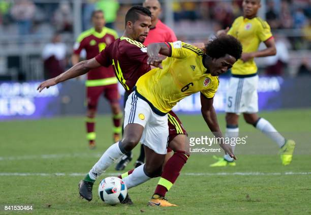 Carlos Sanchez of Colombia and Yangel Herrera of Venezuela compete for the ball during a match between Venezuela and Colombia as part of FIFA 2018...